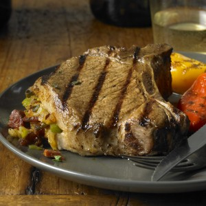 Grilled Pork Chops with Chorizo, Dates and Manchego Stuffing