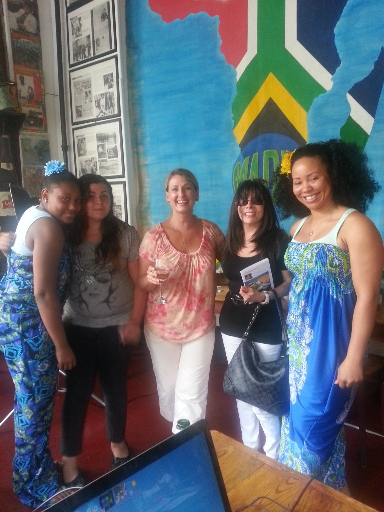 Kristen with students and parents after Cooking with Color 4 Kids class at Madiba Restaurant