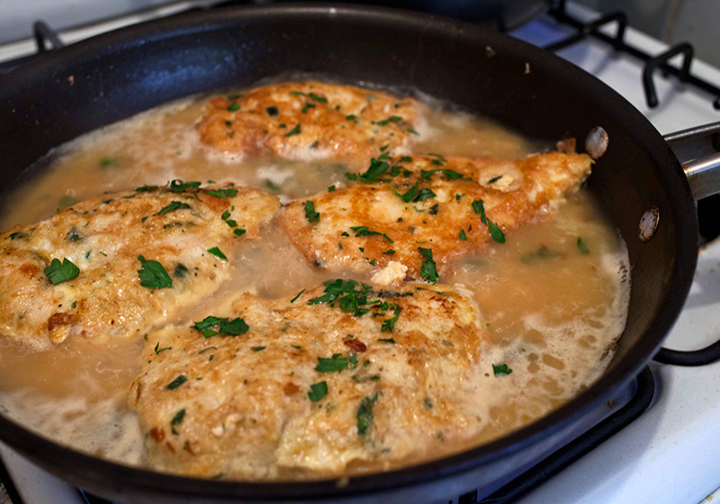 Return chicken to the pan and bring to a boil, cooking for another 5 minutes to let liquid reduce and infuse flavors in the chicken.